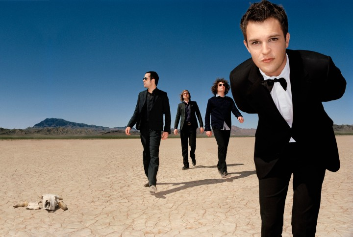 ca. 2005 --- From left: Ronnie Vannucci, Mark Stoermer, Dave Keuning and Brandon Flowers. Styling by Julie Ragolia. Grooming by Kumi Craig. On Brandon, light-blue button-down shirt by Cloak; all else, Brandon's own. On Ronnie, three-piece suit by Acne Jeans; black button-down shirt by Obedient Sons; shoes by Acne Jeans. On Dave, uniform shirt by Cloak; grey button-down shirt by Obedient Sons; pants by Benetton; shoes by A Testoni. On Mark, blazer by Cloak; floral shirt and pants by Ted Baker London; sneakers by PF Flyers. --- Image by © Matthias Clamer/Corbis Outline